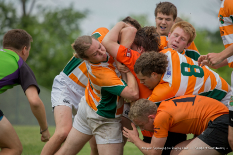 The Oregon-Stoughton High School Rugby Club struggles for the ball in this photograph from the state tournament held in Cottage Grove.